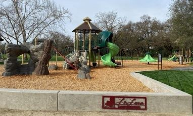 East La Loma Playground features climbing structures, swings, and slides.