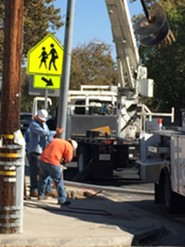 Public Works Personnel Installing Street Light